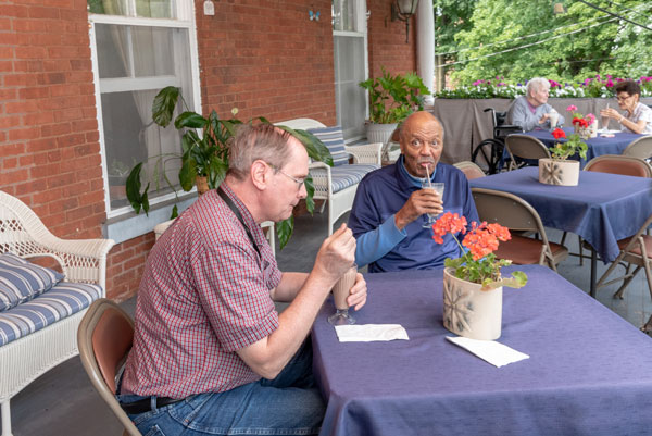 residents having lunch of porch at Vassar Warner Home