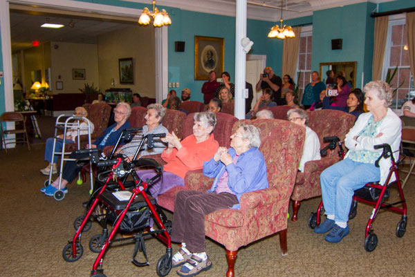 residents watching performance at Vassar Warner Home