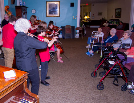 orchestra playing for residents